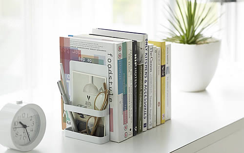 Bookends with storage space for glasses etc