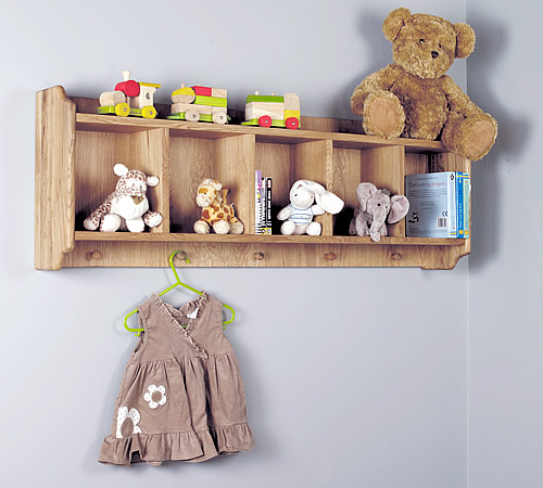 Solid oak shelf with hanging pegs