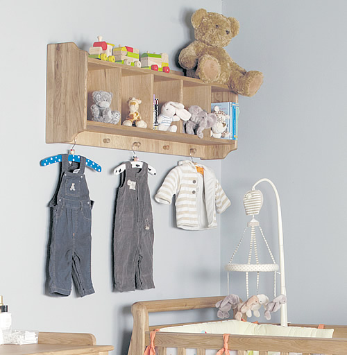 Solid oak shelf with storage cubbies and hanging pegs