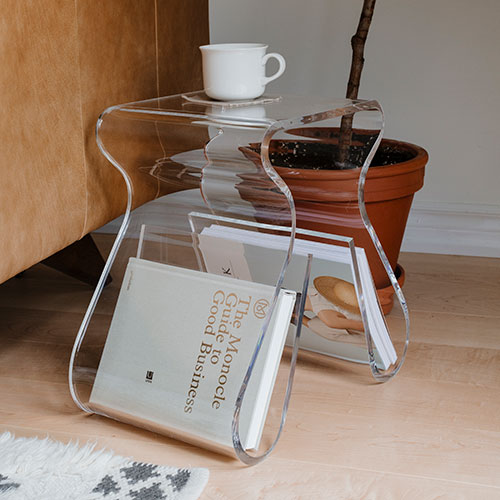 Acrylic stool/side table with integrated magazine rack