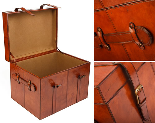 Buffalo leather storage trunk with belt fastening straps and handles