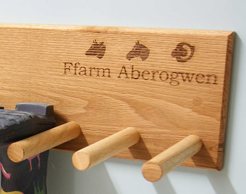 oak welly rack with house or family name added at no extra cost