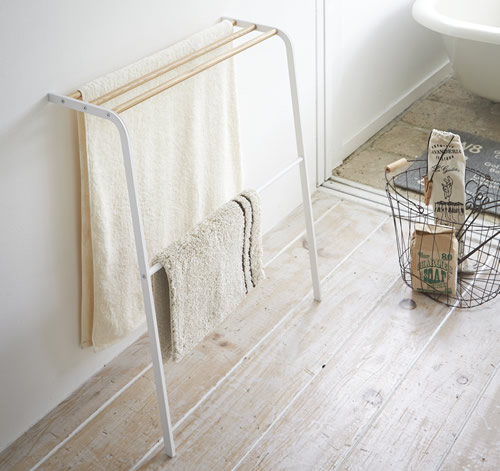 White and wood free standing leaning towel rail