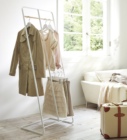 White metal and wood clothes storage rack
