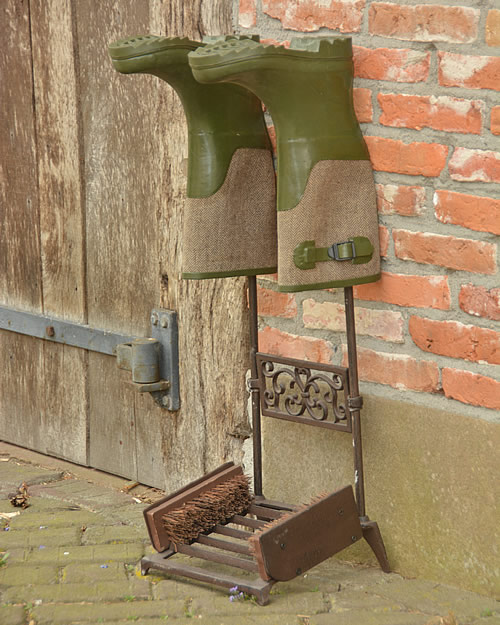 Cast iron boot rack with scraper and brushes