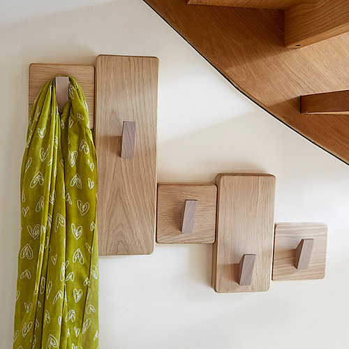 under stairs wooden coat rack made in UK from solid oak finished with 5 coat hooks