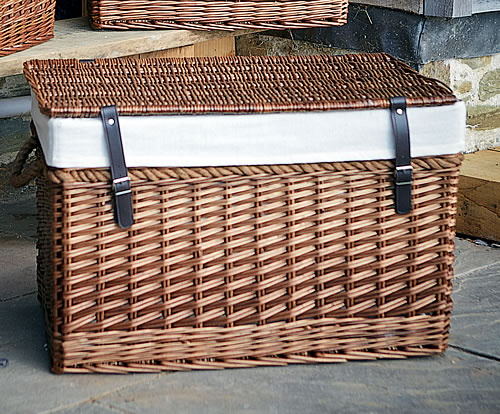Wicker storage chest with rope handles and faux leather fastening straps