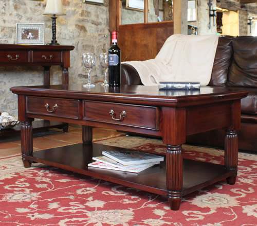 Solid mahogany coffee table with storage drawers and shelf