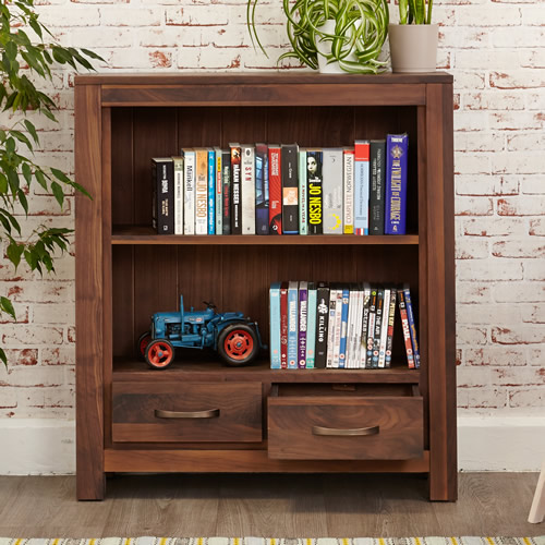 Solid walnut low bookcase with storage drawers