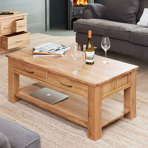 Solid oak coffee table with four drawers