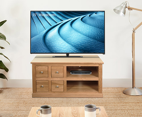 Four drawer solid oak television cabinet