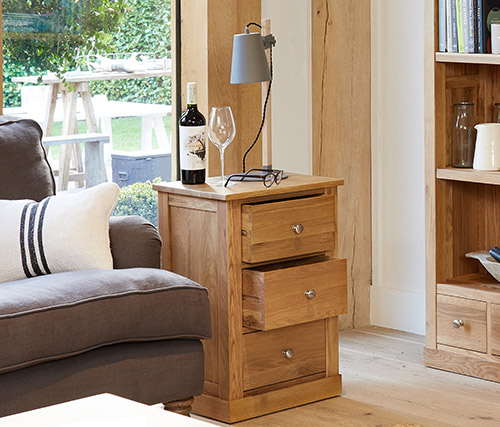 Three drawer solid oak lamp table