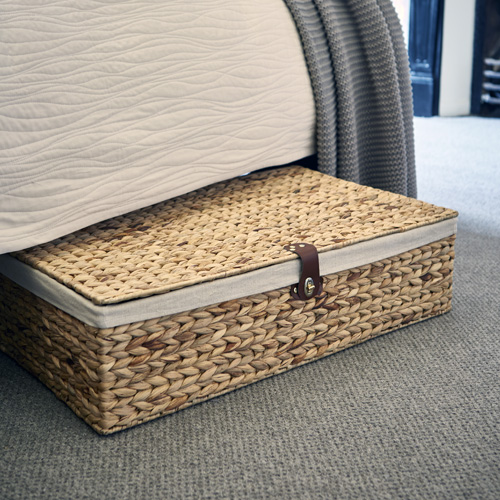 Underbed water hyacinth basket with cotton lining and leather fasten