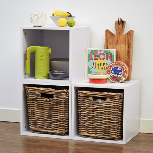 White wood modular storage cubes with rattan baskets