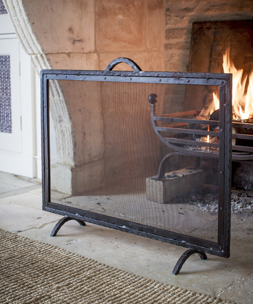 Top quality large classic wrought-iron fire guard.
