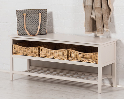 old white wood shoe storage bench with 3 wicker baskets