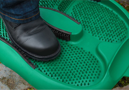 green hallway boot cleaning mat