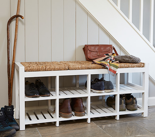 Wooden hallway bench with storage cubbies