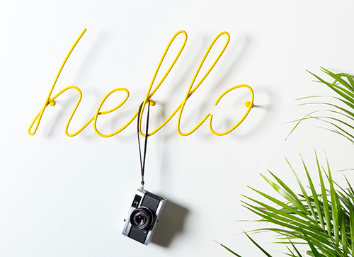 Wall mounted yellow 'hello' coat rack