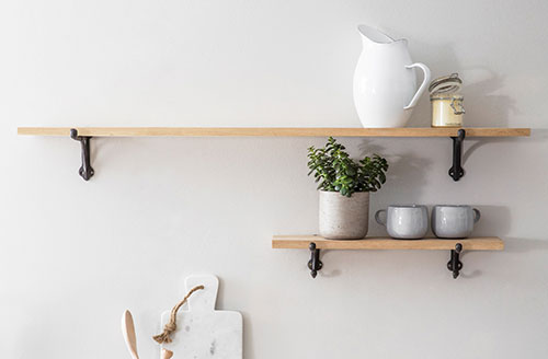 Raw oak wall mounted shelf with cast iron brackets