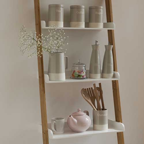 Bamboo and Gloss White Shelf Ladder with Items on the Shelves